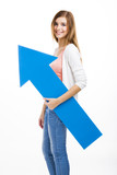 Beautiful blonde woman holding a blue arrow