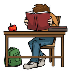 Boy at school at the desk reading a book