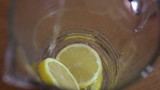 Pouring water on lemon slices, super slow motion, shot at 200