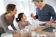 Family in home kitchen preparing pastry