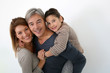 Happy family of three standing on white background