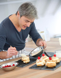 Man in home kitchen preparing pastries