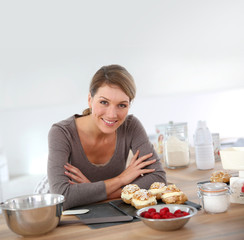 Portrait of beautiful woman baking pastry at home