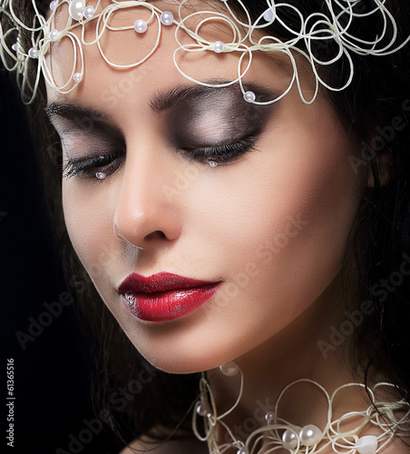 Stylish Fashionable Young Woman with Pearls in Reverie