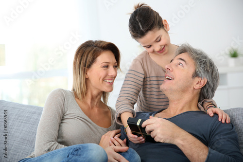 Woman with daughter celebrating father's day