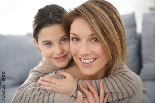 Mother with daughter relaxing at home