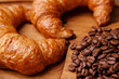 Closeup of croissants and coffee beans