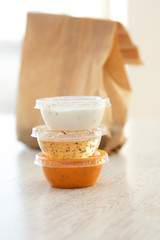 Takeaway plastic bowls with sauces