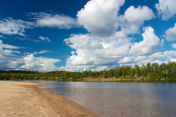 Sandy beach and forest in Ivalo