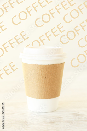 A papercup on a patterned background