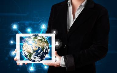 Woman presenting 3d earth globe in modern tablet