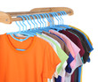 t-shirts hanging on hangers