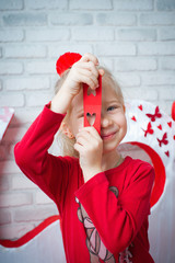 Girl looking through heart-shape