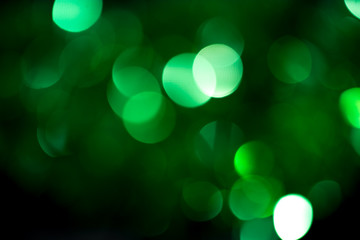 beautiful holiday background of green bokeh