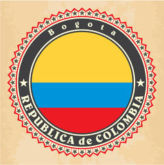 Vintage label cards of Colombia flag. Vector