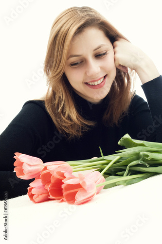 beautiful girl and tulips