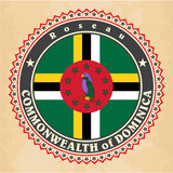 Vintage label cards of Dominica flag. Vector