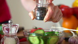 Sprinkle pepper on cucumber salad, super slow motion,