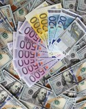 Euro banknotes on a background of one hundred dollars banknotes