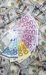 Euro banknotes on a one hundred dollar banknotes