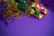 Mardi Gras or Carnivale mask on a purple background - 61371327