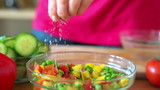 Sprinkle seasonings on fresh salad, super slow motion,