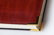 Leather cover book with metal corner