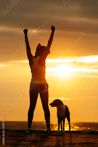 Successful fitness woman and dog