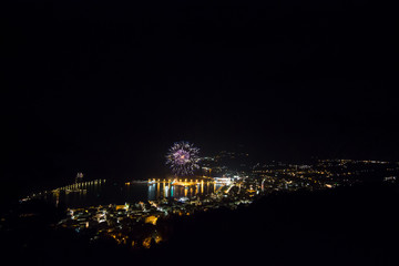 fireworks in a small city at night