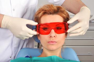 dentist puts goggles