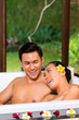 Indonesian couple having wellness bath in spa