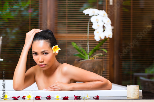 canvas print picture Indonesian woman having wellness bath in spa