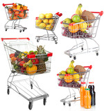 Trolleys with different fruits and vegetables isolated on white