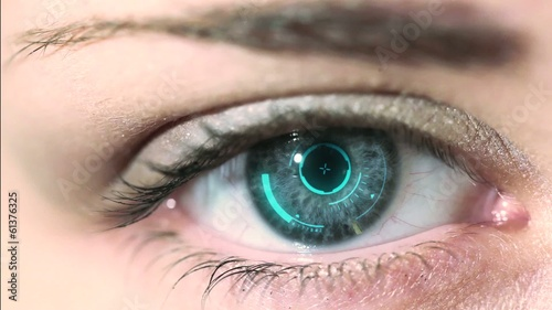 Close up to woman's eyeball with futuristic system.