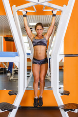 Sporty woman in the gym.