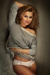Smiling sensual blonde lady posing.