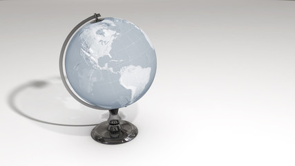 A crystal globe on a chrome pedestal over white
