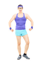 Full length portrait of young guy in sportswear showing muscle