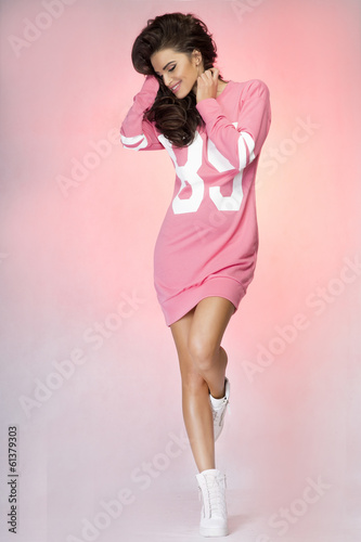 Attractive brunette woman posing in studio.