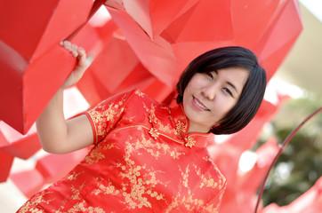asian woman wearing a cheongsam