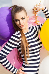 beautiful lady in short black and white striped dress holds bunc
