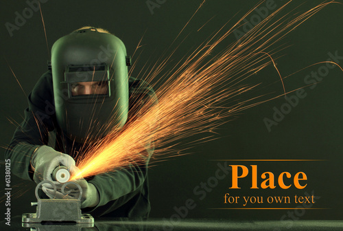Portrait of workman in black mask on black background