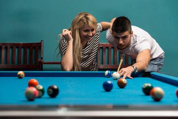 Couple Playing Billard
