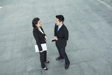Above view of Asian Business people talking to each other.