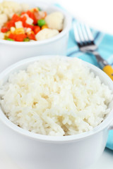 Cooked rice and vegetables close up