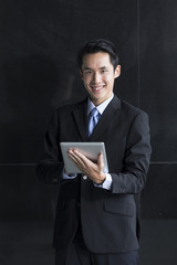 Chinese man with a tablet computer.