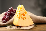 Piece of cheese with grape and rosemary - 61381326