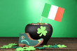 Saint Patrick day boot, pot of gold coins and clover leaves