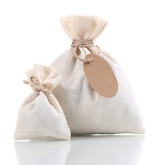 Sackcloth bags with blank label, isolated on white