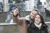 romantic couple in the city taking a selfie poster